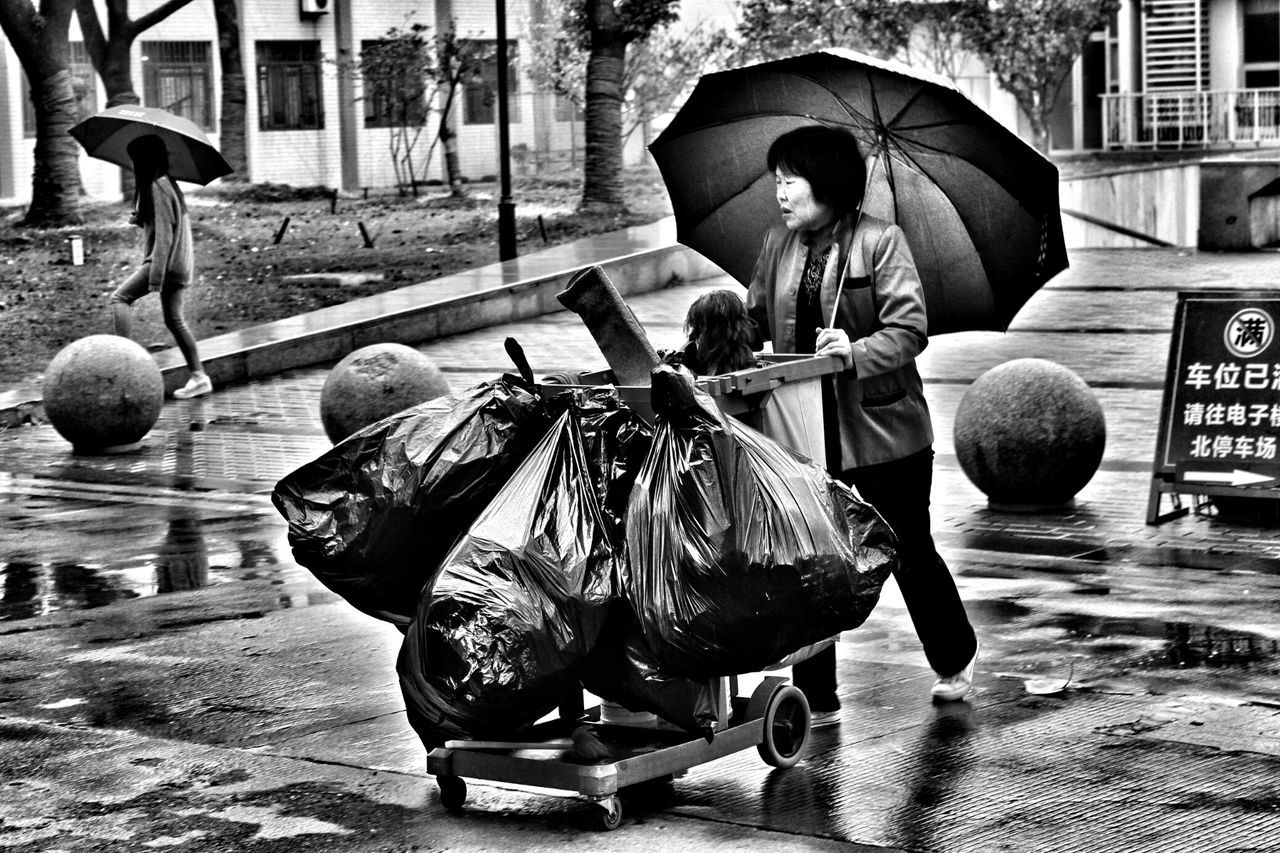 Madame Umbrella Rain By Chance Labour Black And White Peoplephotography Ordinarypeople