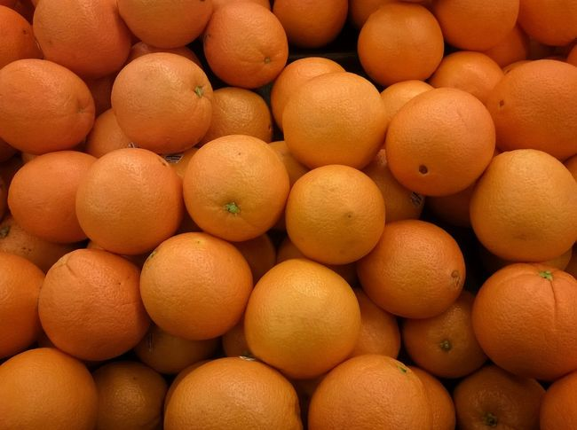 A bunch of oranges. Fruit No People Food Shopping Vitamin C Foodphotography Healthy Market Grocery Shopping Food Orange Round Eye4photography  Taking Photos Citrus  Citrus Fruits Getty Images Getty X EyeEm Healthy Food Hunger Hungry