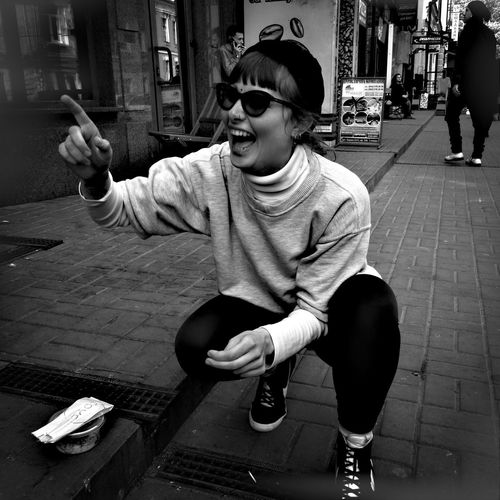 The Street Photographer - 2017 EyeEm Awards Sitting Real People Casual Clothing One Person Lifestyles Happiness Day Technology Outdoors Young Adult People