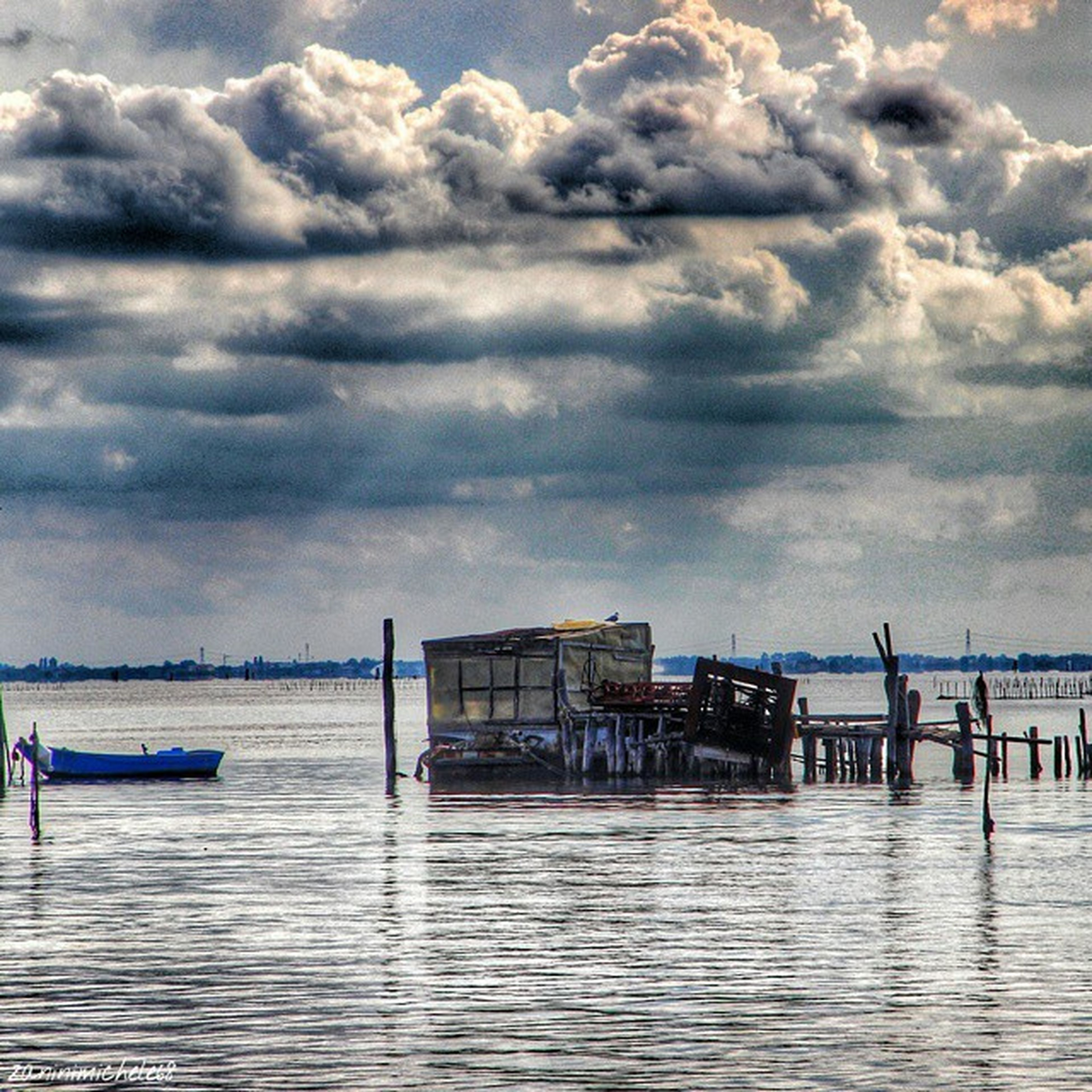 water, sea, sky, cloud - sky, pier, cloudy, waterfront, tranquil scene, tranquility, scenics, horizon over water, cloud, nature, beauty in nature, built structure, rippled, idyllic, weather, jetty, outdoors