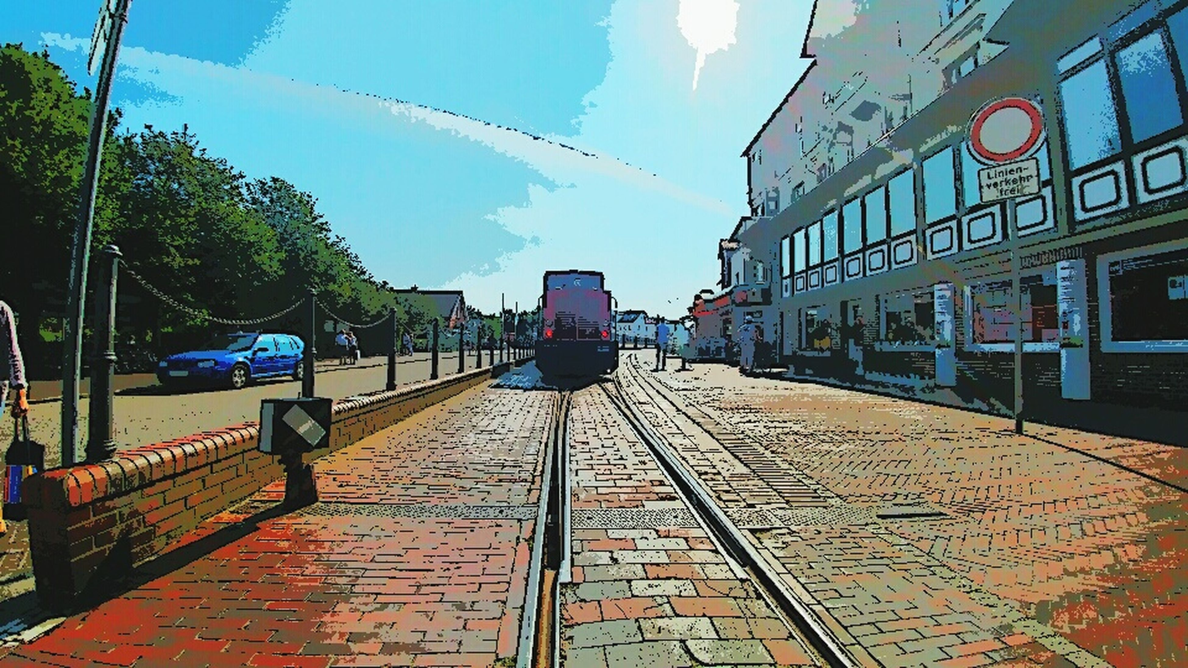 architecture, built structure, building exterior, transportation, railroad track, sky, city, city life, the way forward, day, outdoors, diminishing perspective, blue