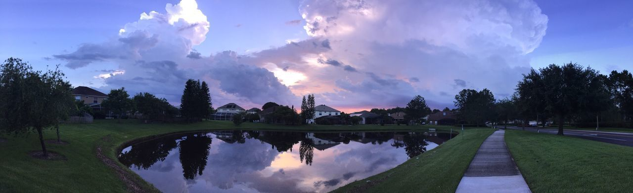 sky, cloud - sky, tree, water, nature, building exterior, architecture, outdoors, beauty in nature, growth, reflection, built structure, park - man made space, scenics, day, no people, panoramic, grass