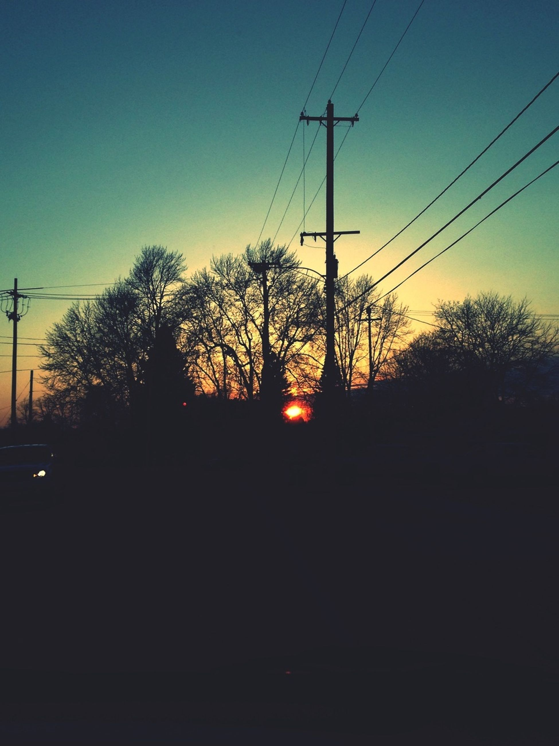 electricity pylon, power line, silhouette, sunset, electricity, power supply, cable, tree, connection, fuel and power generation, clear sky, sky, power cable, technology, tranquility, tranquil scene, nature, dusk, scenics, orange color