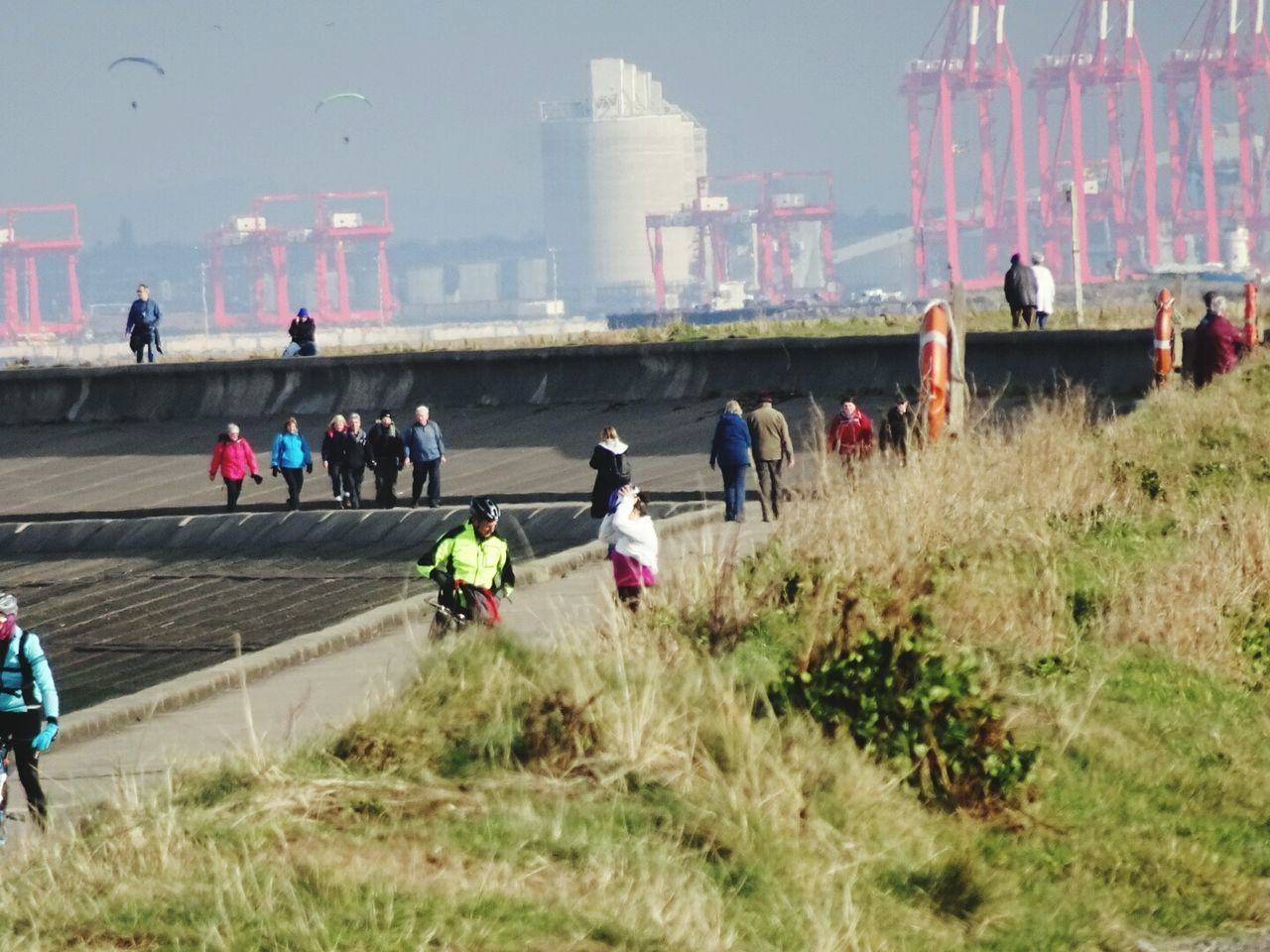 Sunday morning Leisure Activity People Embankment Wallasey Outdoors Day Walking Along Embankment Real People Liverpool Docks In Background Paragliders Coastline Fresh Air Winters Day Nature Coastal Walk