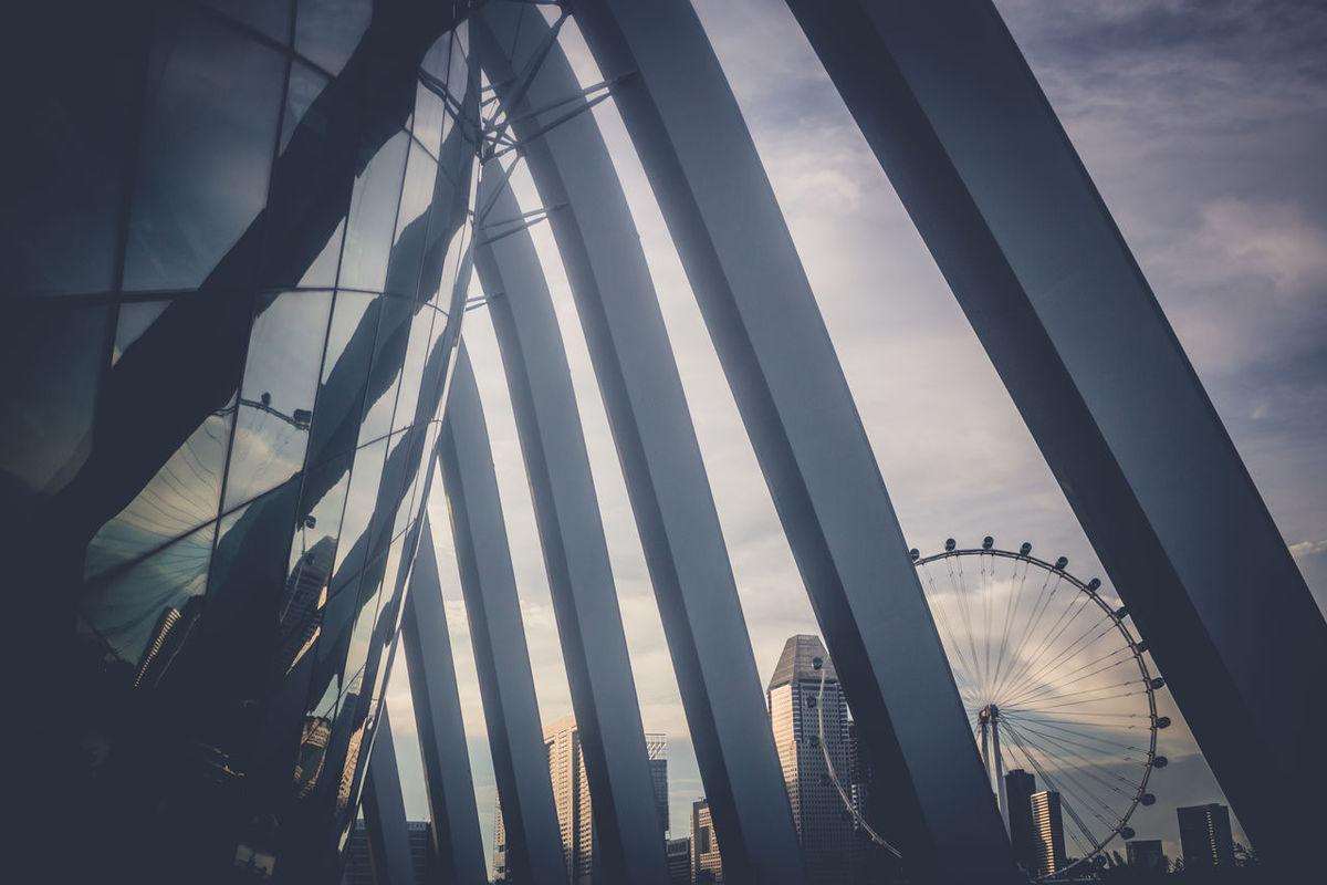 Architecture Bulding Ferrys Wheel Glass Reflection Low Angle View Pillars Reflection Sightseeing Sunset Symmetry Urban Geometry