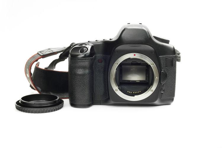 Photo camera reflex showing its sensor on white isolated background. Camera - Photographic Equipment Isolated Reflex Digital Camera Isolated White Background Photo Sensor Camera. White Background White Isolated