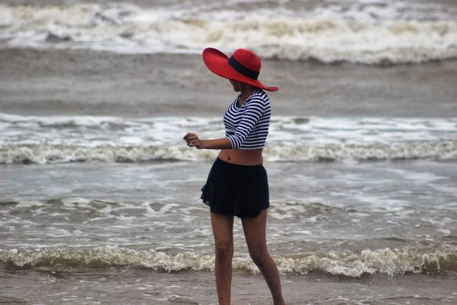 portrait Beach Beauty In Nature Carefree Casual Clothing Day Focus On Foreground Full Length Getting Away From It All Leisure Activity Lifestyles Nature Outdoors Person Portrait Photography Scenics Sea Shore Standing Tourism Tourist Tranquil Scene Tranquility Vacations Water Wave