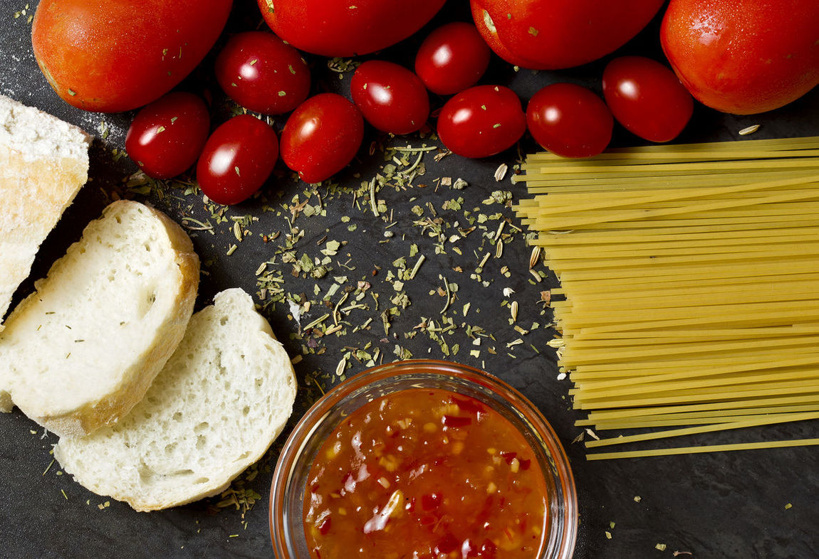 Italian food background with bread,pasta,tomatoes and tomato spicy sauce Breads Chilli Sauce Ciabatta Ciabatta Bread Food Food And Drink Freshness Healthy Eating Herbs Indoors  Italian Food No People Raw Ready-to-eat Red Sauce Slices Of Bread Spagetti Tomato Tomatoes