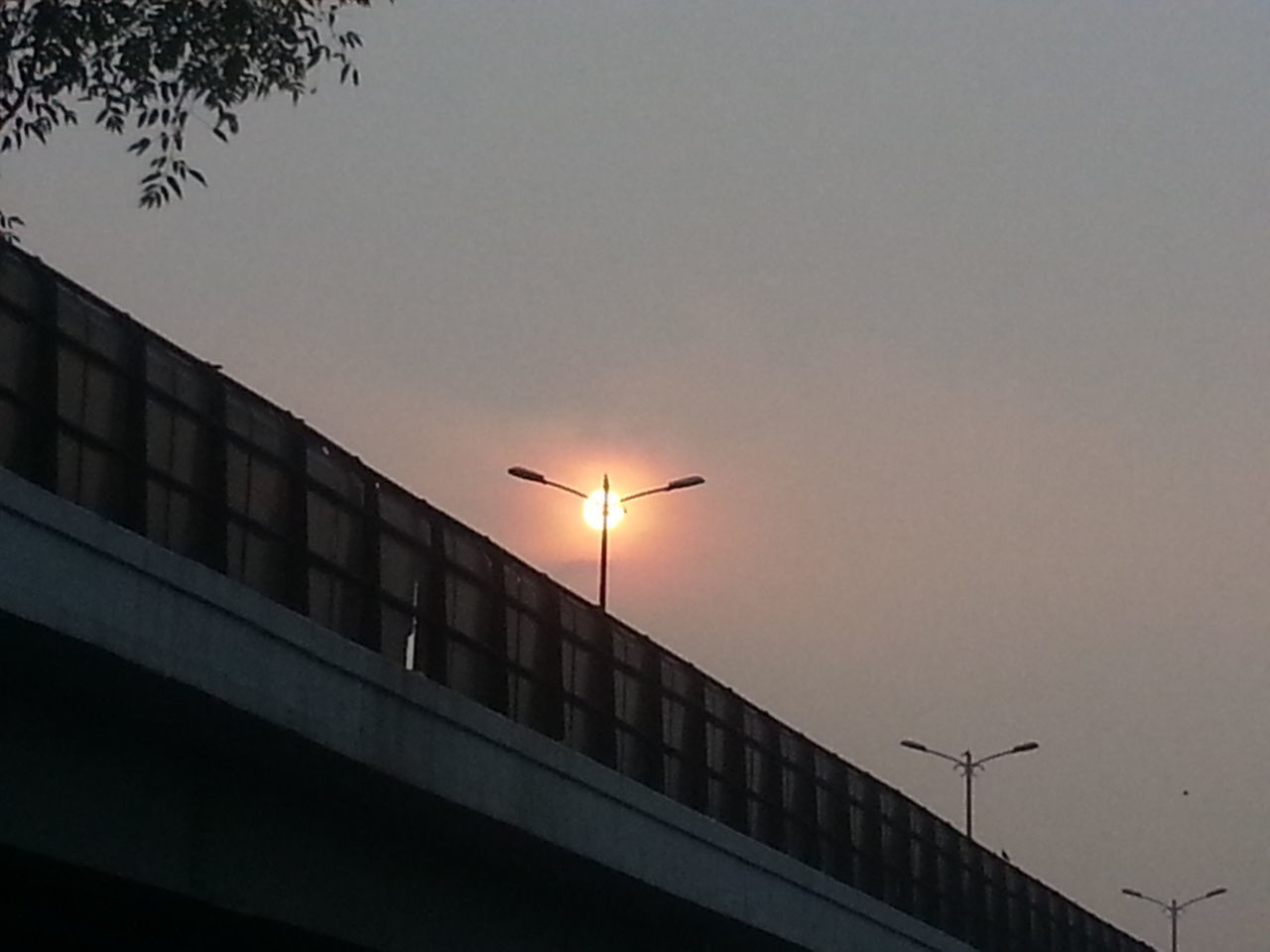 The lamp on this post is just really bright ! Sunset_collection Sunset Evening Sky Evening Glow Evening Sun Dusky Sky