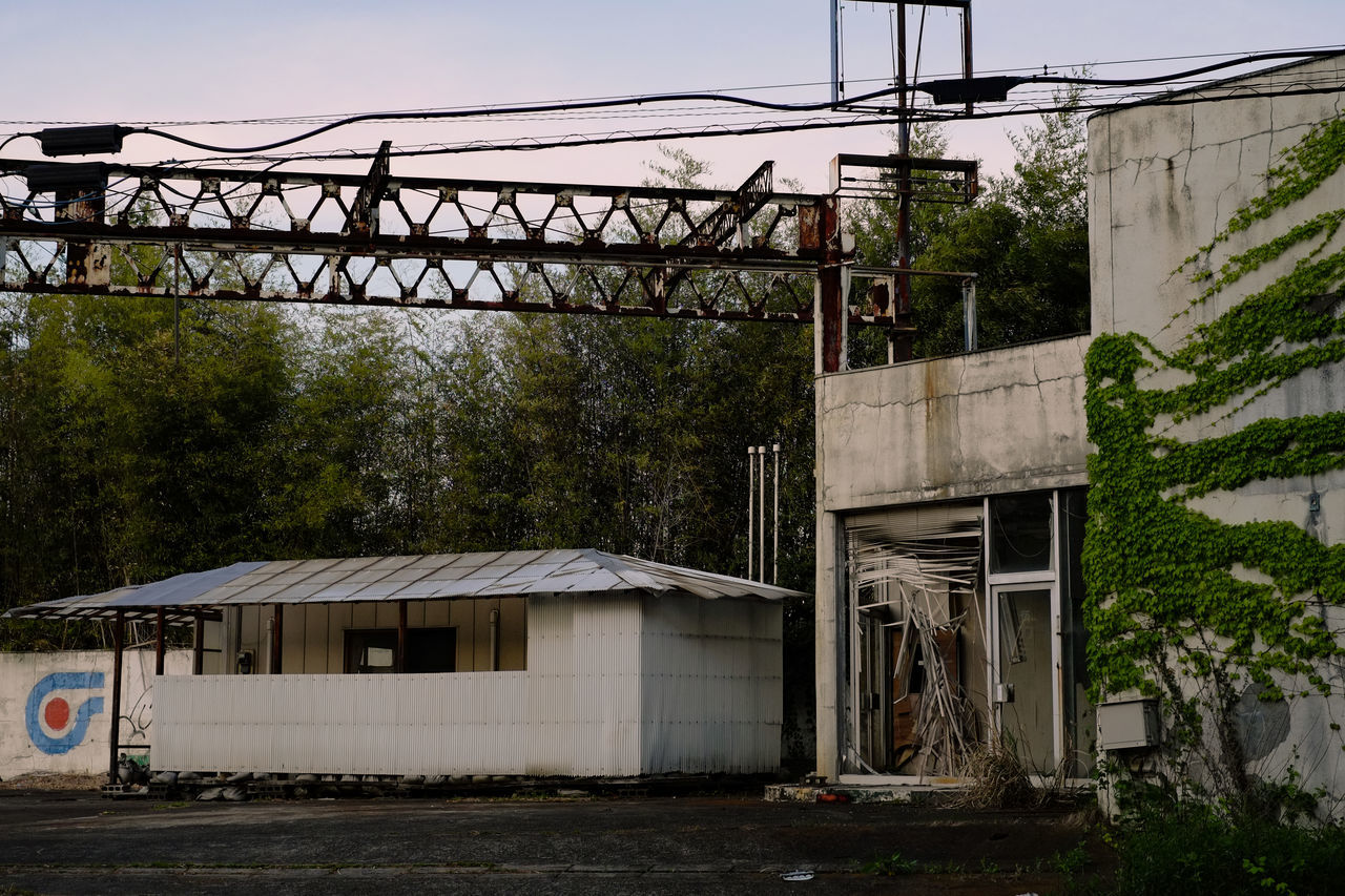 An abandoned gas station. Abandoned Abandoned Buildings Abandoned Places Architecture Built Structure Day Electricity  Electricity Pylon Fujifilm Fujifilm_xseries Gas Station Japan No People Outdoors Sky
