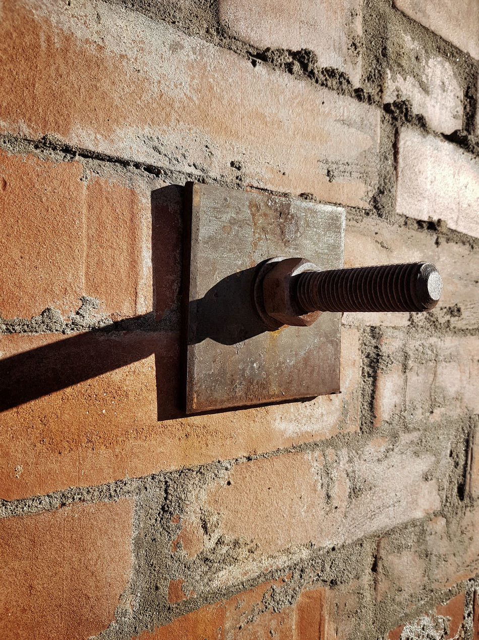 Architecture Bolt Brick Wall Building Exterior Built Structure Close-up Day Long Metal No People Nut Outdoors Rust Rusty Shadow Shadow And Light Shadows & Lights Sun Sundial Sunny Wall - Building Feature