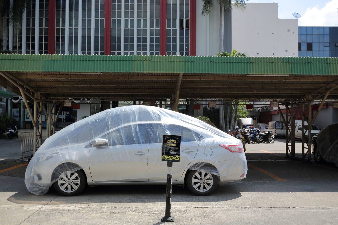 With a plastic cover a car can surely survive much better in a dusty city like Bangkok. Adapted To The City Architecture Building Exterior Built Structure Car City Cover Covering Day Dust Garage Land Vehicle Mode Of Transport No People Outdoors Parking Plastic Stationary Transportation