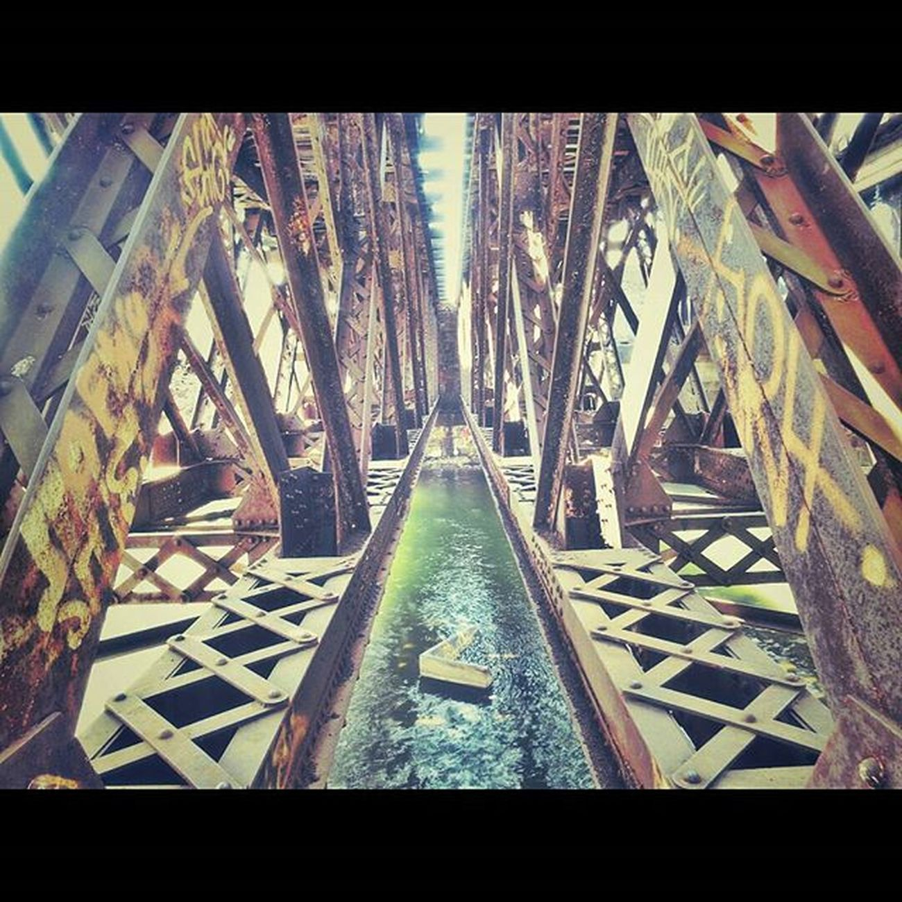 Filtered (w/ Pixlr )view under a railroad bridge in Pittsfield, MA. : : Pittsfield PittsfieldMA IntheBerkshires Berkshires Theberkshires Igers413 Igersnewengland Igersmass Urbanexploration Urbanabstractions Streetshooter Streetphotography RailRoadTracks Traintracks Abstractart Industriallandscape Urbanlandscape ExploreEverything Newtopographics Yetmagazine Noicemag Onbooooooom Rentalmag Createdaily abstractphotography digitalart picoftheday PhotoOfTheDay Overfiltered