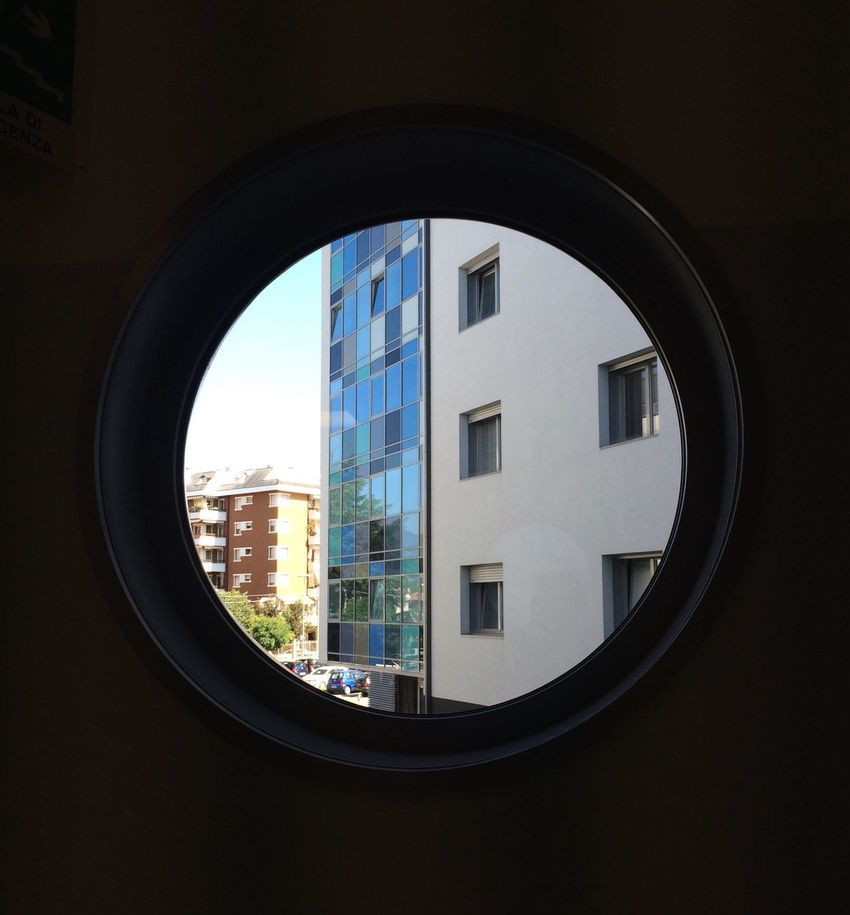 Window Architecture City Building Exterior Indoors  Geometric Shape Circle Cityscape Circular City Life Aviewfrominside Inside Out FromTheWindow Watching From The Window Looking Out Of The Window Lookingoutside Roundwindow Frominside