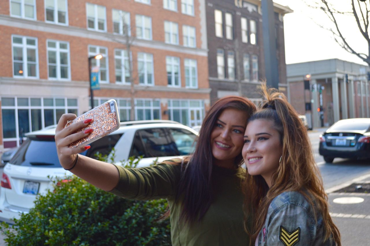 💎🔥 Photography Themes Selfie Photo Messaging Photographing Two People City Young Women Smart Phone Tourist Happiness Portable Information Device Young Adult Holding Wireless Technology Adults Only Women Communication Technology Adult Smiling Mobile Conversations Women Around The World