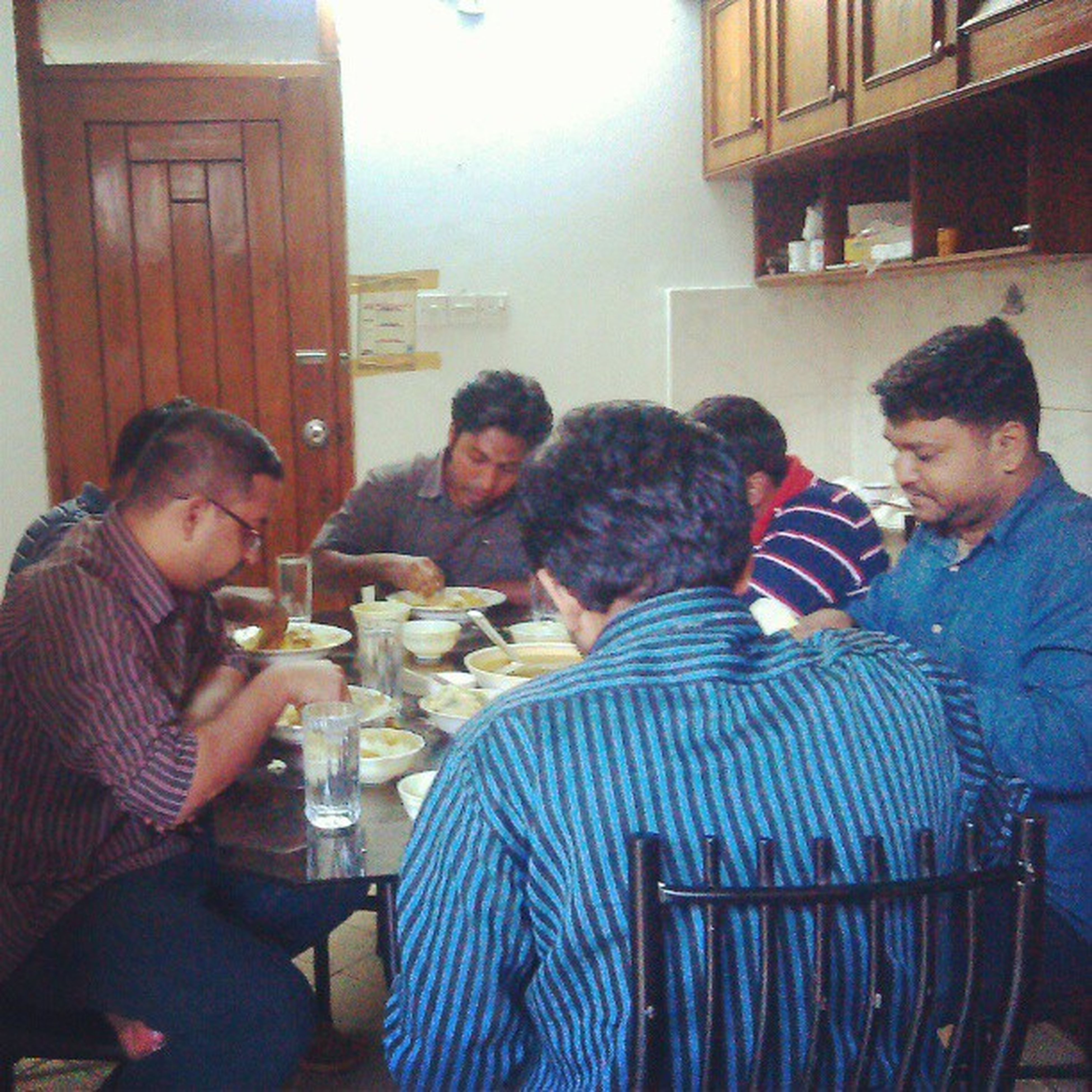 indoors, togetherness, lifestyles, person, bonding, leisure activity, casual clothing, love, friendship, young men, sitting, young adult, family, waist up, happiness, boys, smiling, wireless technology
