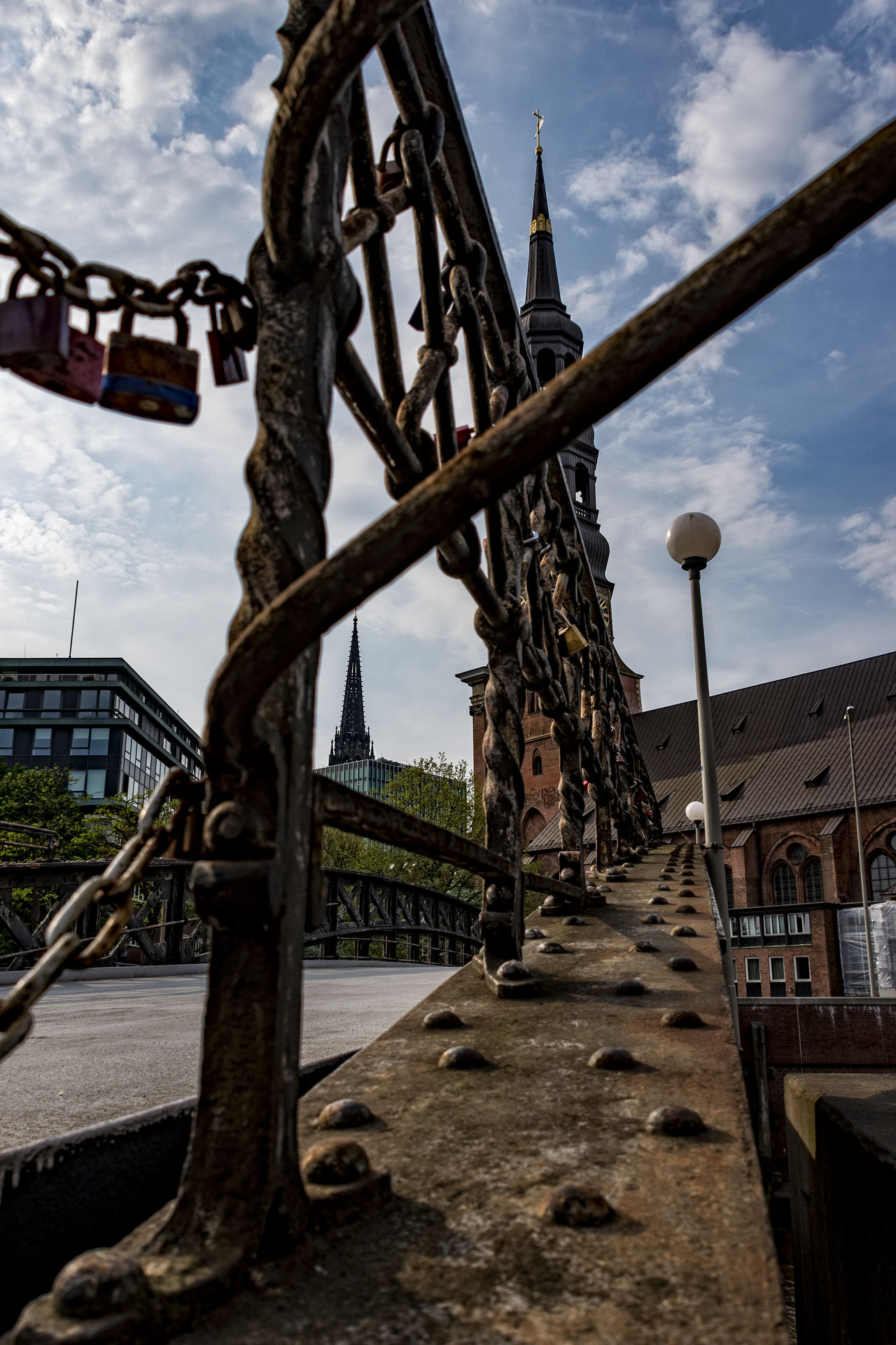 Jungfernbrücke Architecture Bridge Building Exterior Built Structure Church Church Tower City Cloud - Sky Day Hamburg Harbour Iron - Metal Jungfernbrücke Lantern Nature No People Outdoors Padlocks Railing Sky Speicherstadt Hamburg