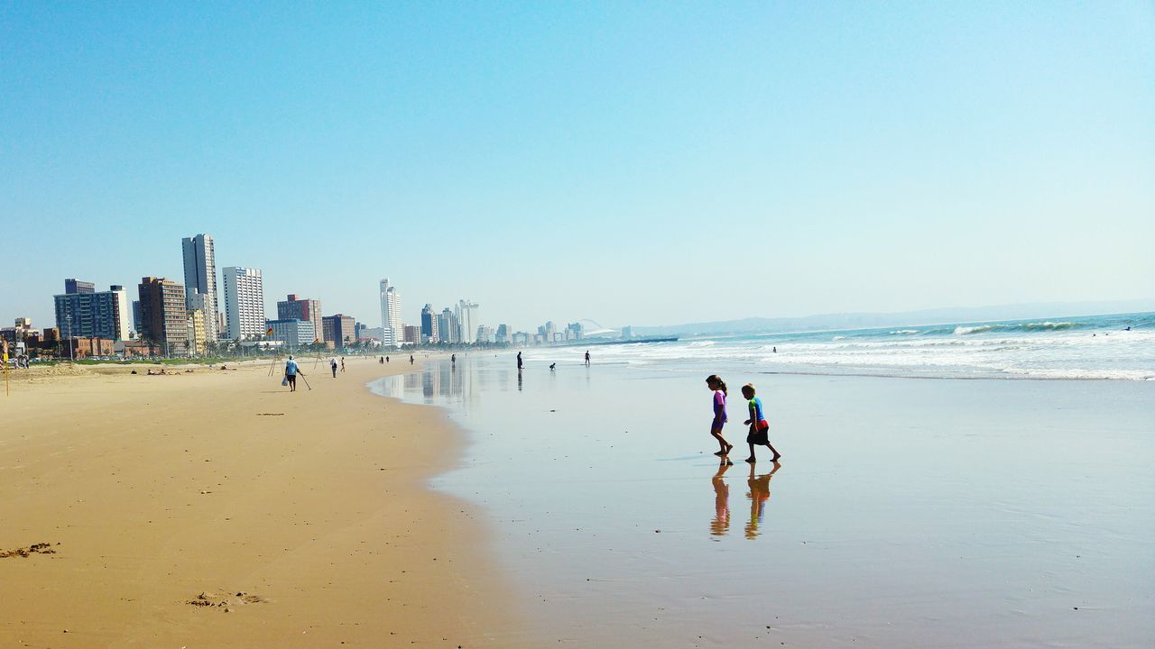 Friendship Children Photography Sea Children Playing Children At Play Enjoying The Sun Sea Side Beach WalkDurban South Africa Beachphotography Beachwalk Cityscapes City View  City Skyline Cityworldwide Lost In The Landscape Be. Ready.