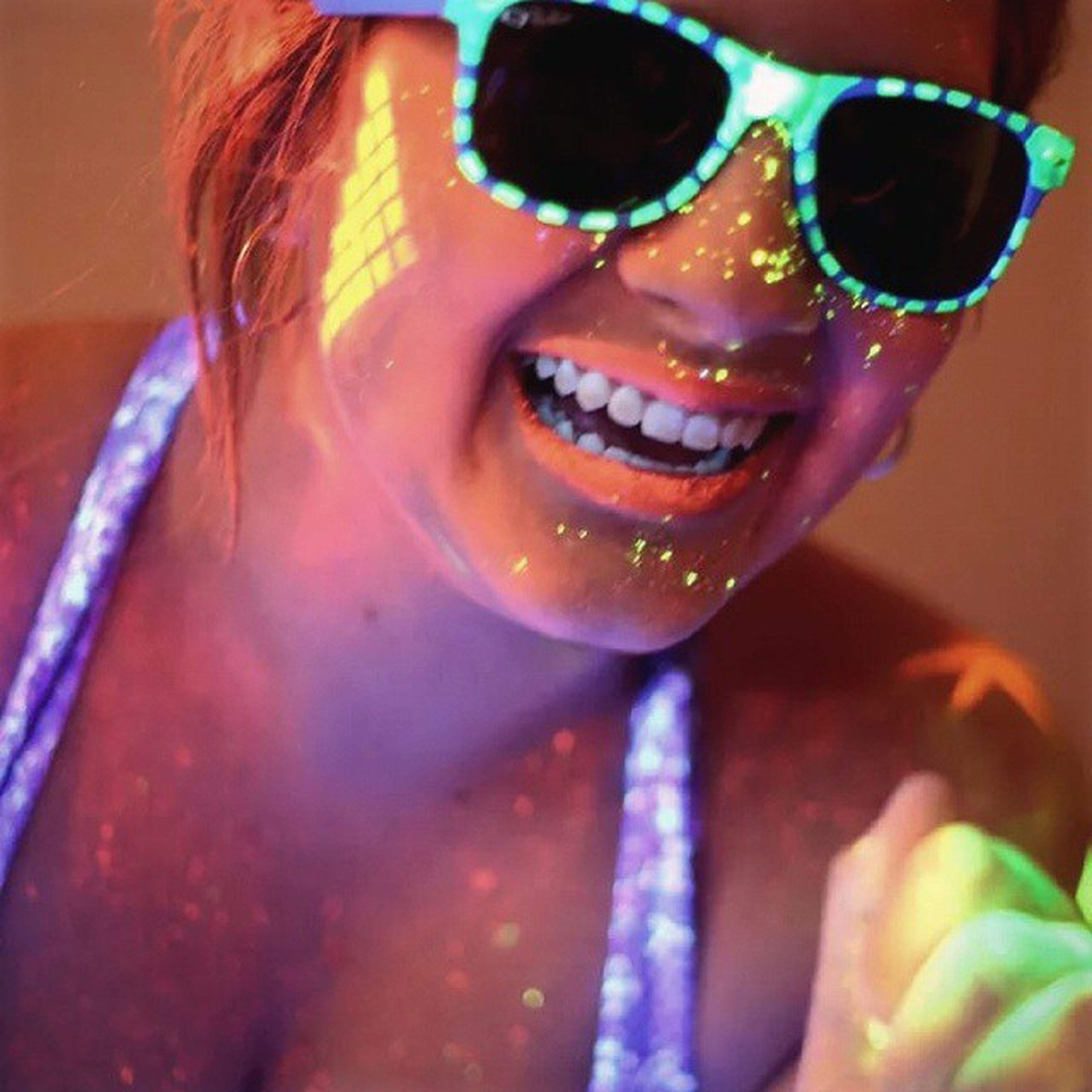 lifestyles, leisure activity, close-up, childhood, indoors, holding, part of, focus on foreground, water, sunglasses, reflection, person, day, refreshment, sunlight, casual clothing, wet