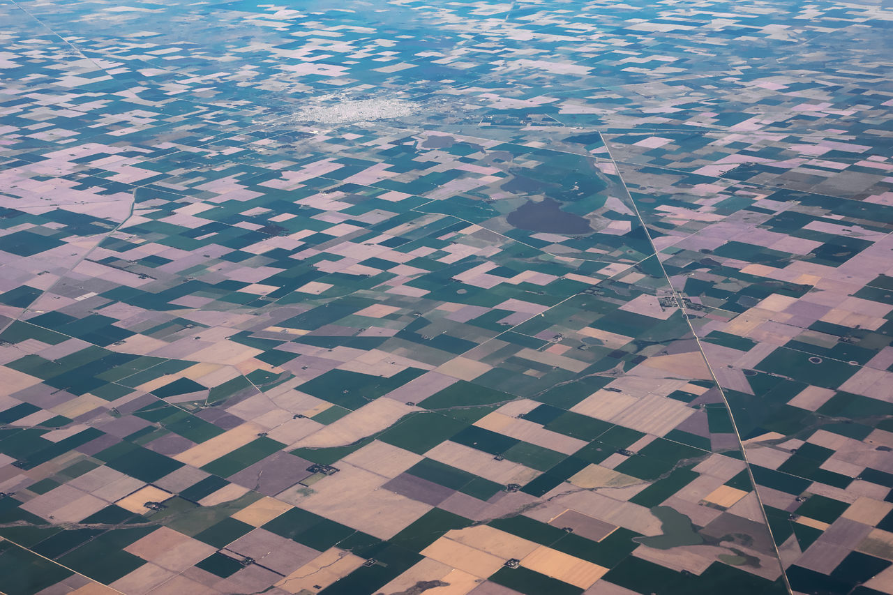 agriculture, high angle view, aerial view, full frame, patchwork landscape, nature, tranquil scene, day, pattern, tranquility, outdoors, beauty in nature, scenics, landscape, water, no people