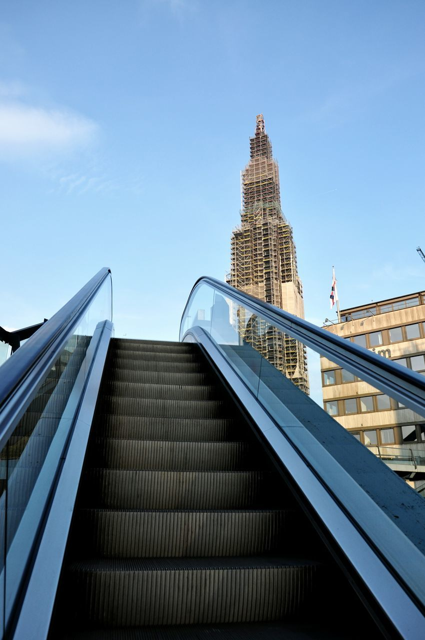 architecture, built structure, staircase, modern, steps and staircases, railing, steps, building exterior, city, skyscraper, low angle view, sky, day, outdoors, no people