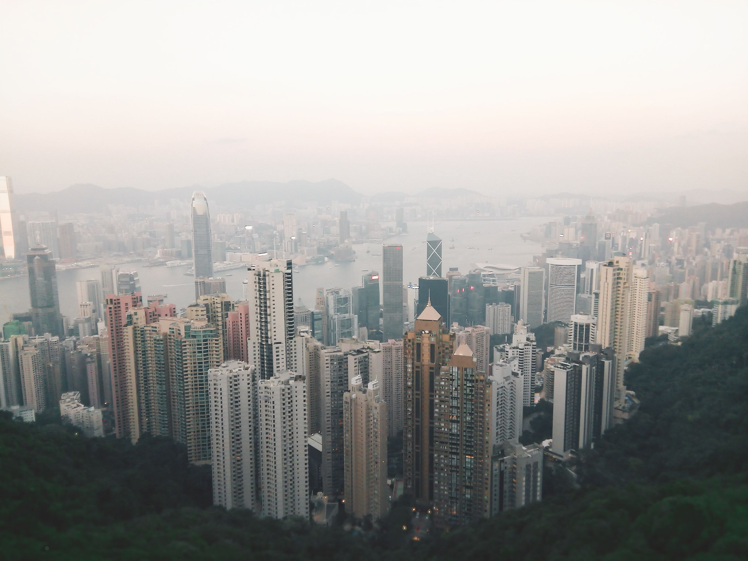cityscape, skyscraper, architecture, city, building exterior, modern, crowded, built structure, urban skyline, outdoors, growth, travel destinations, day, sky, nature, office park