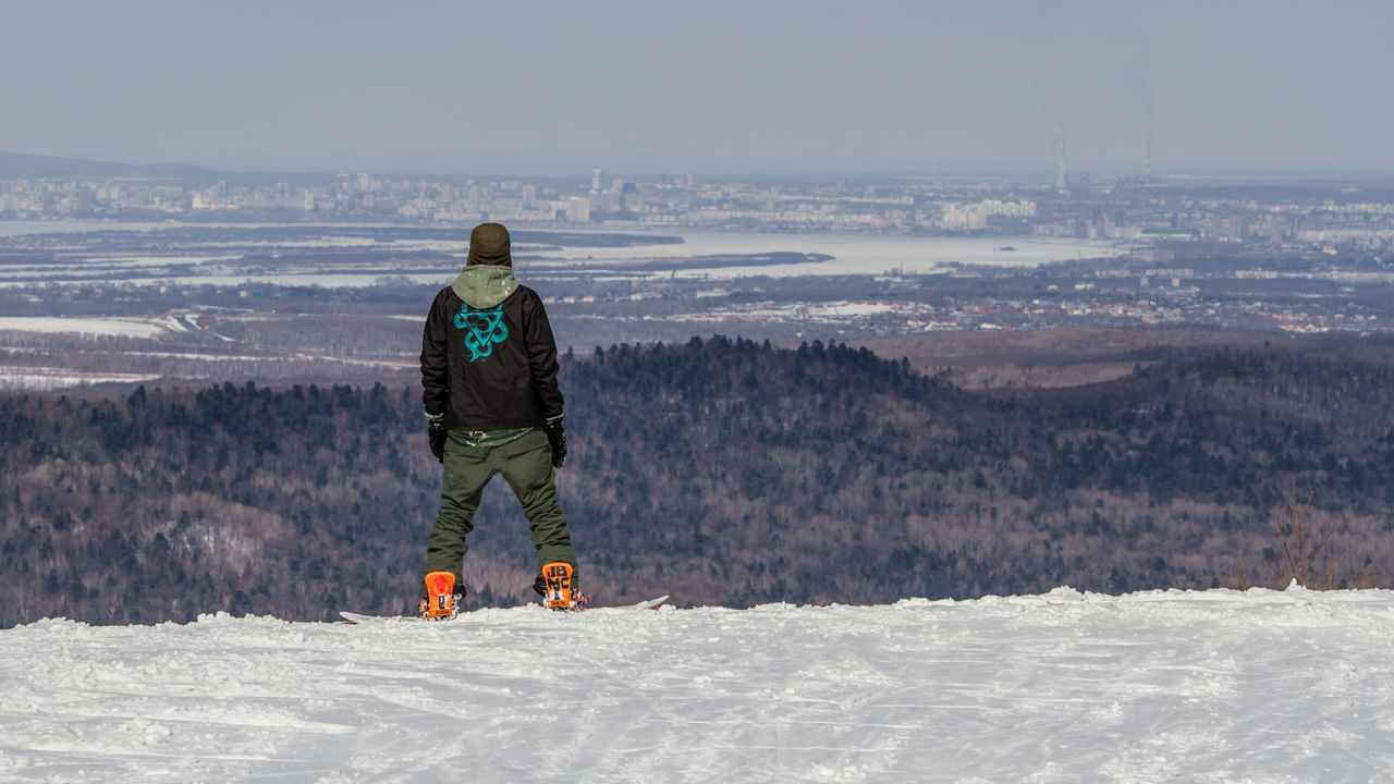 View of the Khabarovsk city from Khekhtsir mount Adult Adults Only Adventure Beauty In Nature Cold Temperature Day Full Length Landscape Leisure Activity Lifestyles Men Nature One Person Outdoors People Real People Rear View Scenics Sky Snow Snowboard Snowboarding Snowboards Warm Clothing Winter