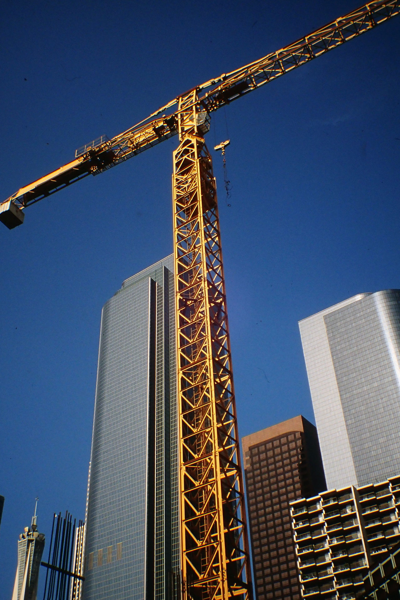 Architecture Blue Building Exterior Built Structure Clear Sky Construction Construction Crane Construction Site Day Los Angeles, California Low Angle View No People Outdoors Sky USA
