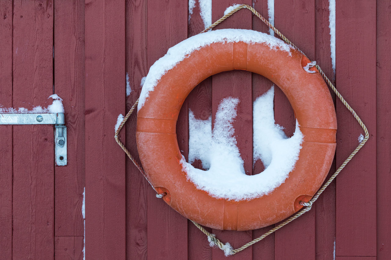 Orange life buoy hanging on the wooden wall of a boathouse Architecture Assistance Boathouse Buoy Circle Close-up Cold Temperature Day Emergency Sign Equipment Full Frame Hanging Lofoten And Vesteral Islands No People Outdoors Protection Red Rescue Rope Safety Security System Snow Wall - Building Feature Winter Wood - Material