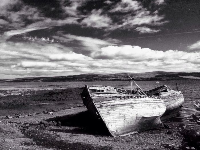 Boat Nautical Vessel Transportation Beach Moored Sky Abandoned Sand Shore Mode Of Transport Tranquility Water Discard Old Tranquil Scene Lake Calm Lakeshore Cloud - Sky Cloud Shipwreck Ship Blackandwhite
