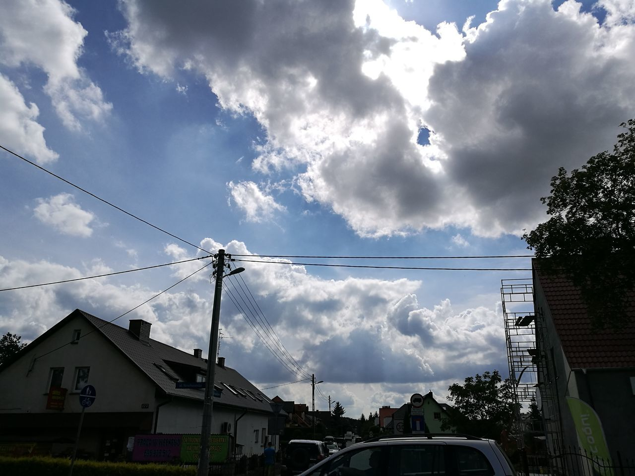 cloud - sky, sky, built structure, building exterior, architecture, cable, day, power line, house, outdoors, low angle view, no people, car, transportation, tree, electricity pylon, nature