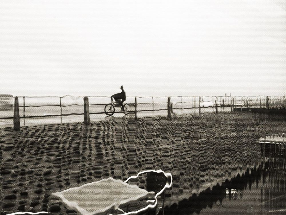 A brave and intrepid cyclist in Shoreham. Taking Photos