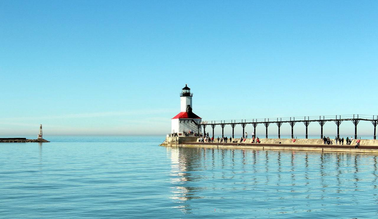 LightHouse at the Lake Michigan - postcard Light Tower Waterfront Architecture Beach Life Beauty In Nature Blue Building Exterior Built Structure Clear Sky Copy Space Over Nature Day Guidance Lake Lighthouse Nature No People Outdoors Protection Sea Sky Tourist Attaction Vacation Destination Water