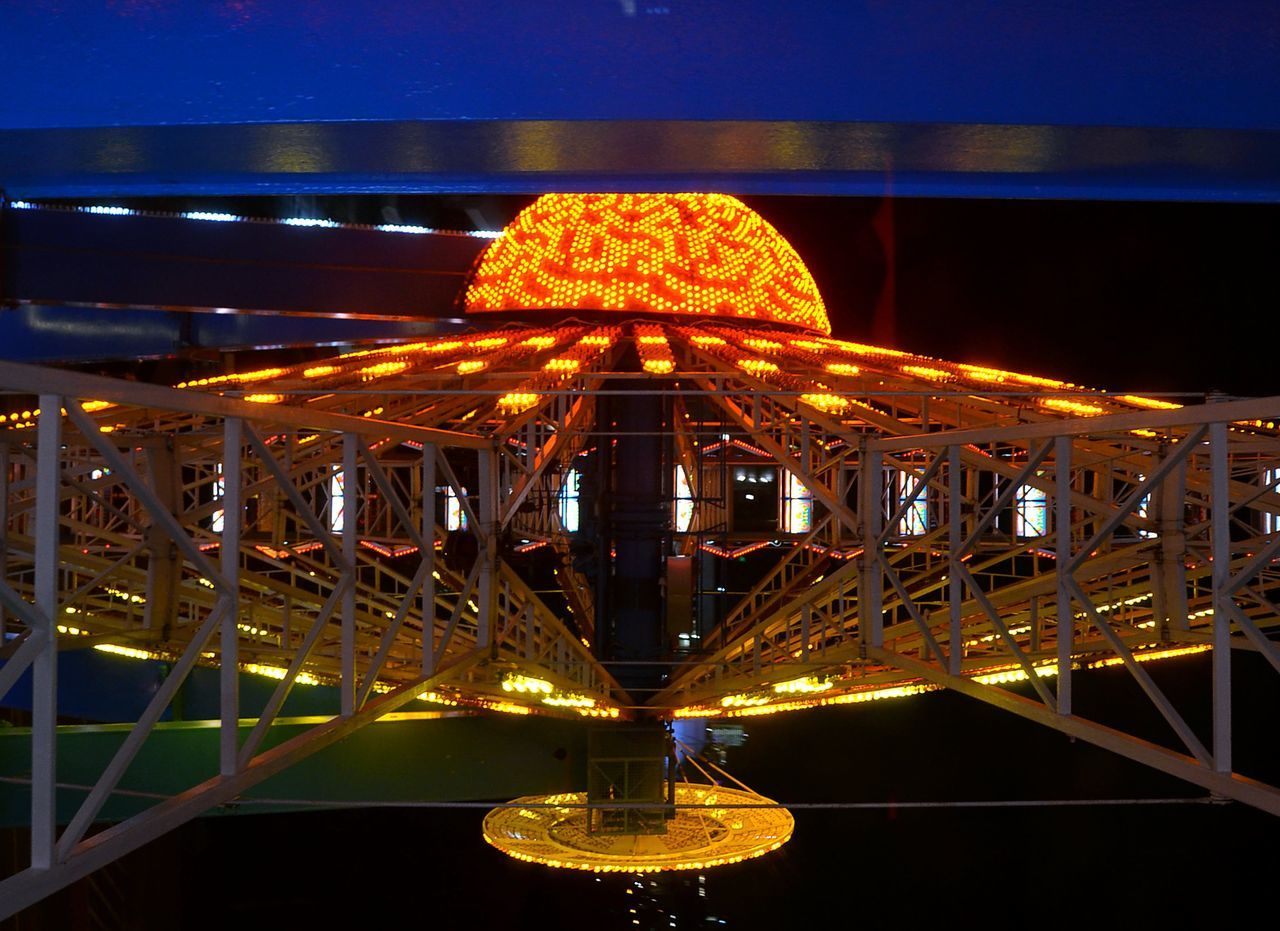 Illuminated Spaceman Outdoors Fairground Nightphotography Multicolored Ferris Wheel UFO Yellow Color FlyHigh SpaceShip Space Shuttle Riesenrad Close Up Technology