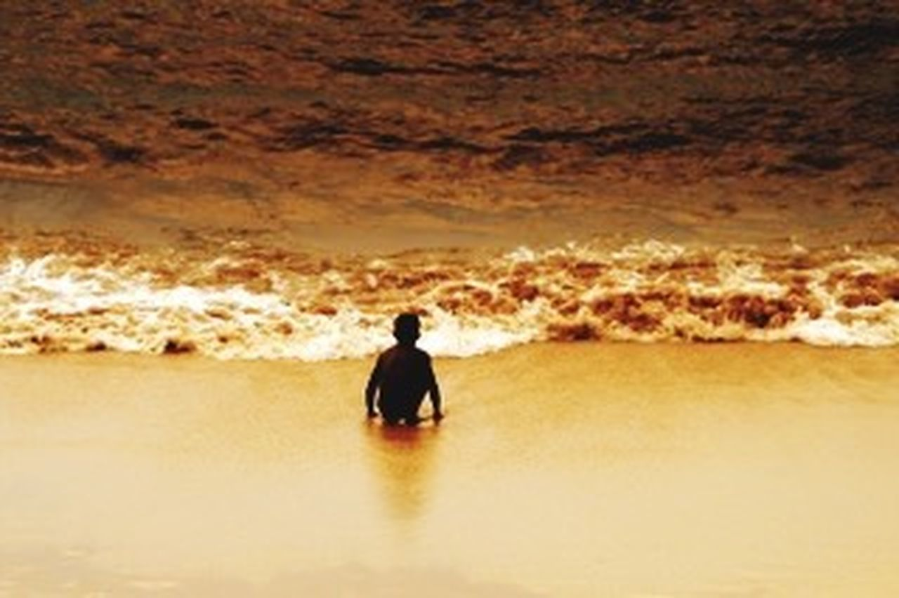 sunset, sea, one person, rear view, one man only, silhouette, nature, reflection, outdoors, beach, only men, scenics, beauty in nature, adults only, adult, people, wave, vacations, men, water, sky, day