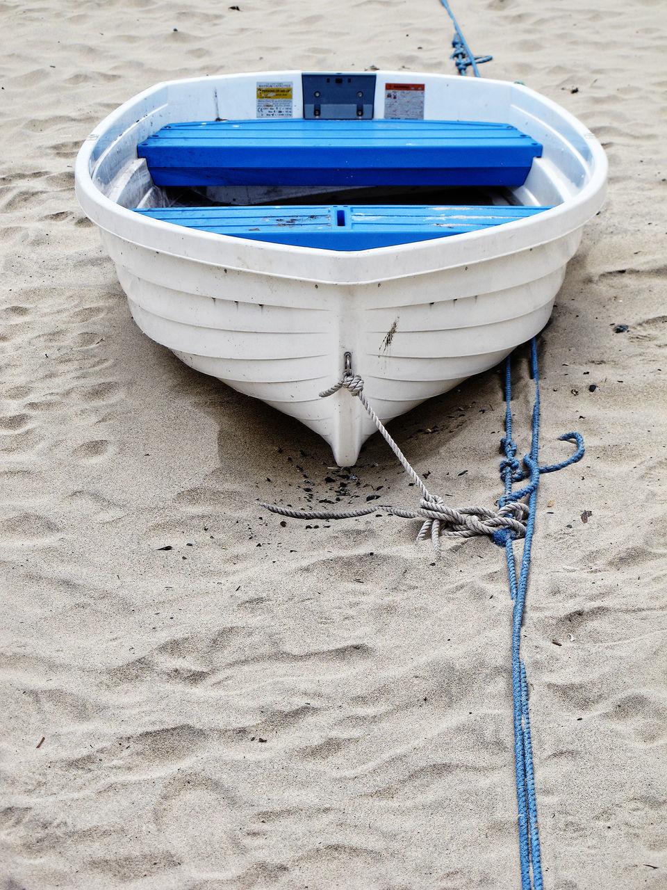 White Rowboat Moored At Beach