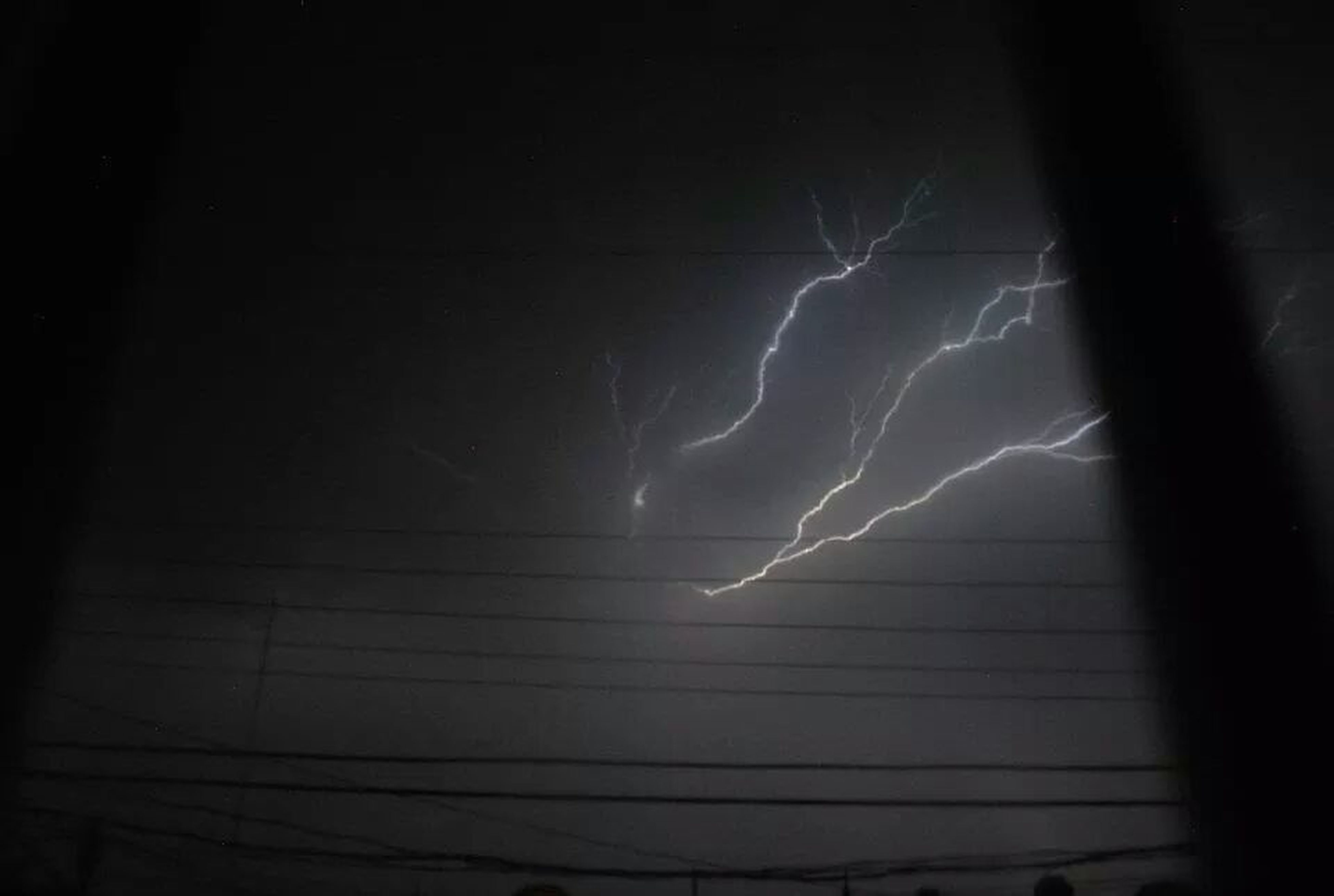 night, sky, silhouette, scenics, low angle view, lightning, nature, power in nature, beauty in nature, dark, tranquility, tranquil scene, weather, illuminated, dusk, electricity, outdoors, thunderstorm, no people, cloud - sky