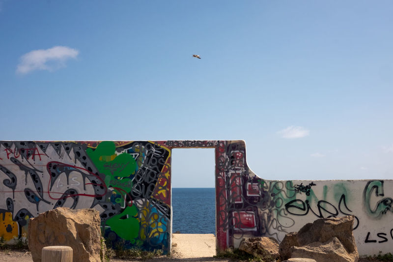 gate to unknown Gate Unknown Graffiti Street Art Sea Sky Outdoors Day Horizon Over Water Travel Photography Modern Art Modern Actual Cave Painting Fujifilm_xseries Fuji X-T10 Sea Art Wall Painting Wall Wall Art Wallpainting
