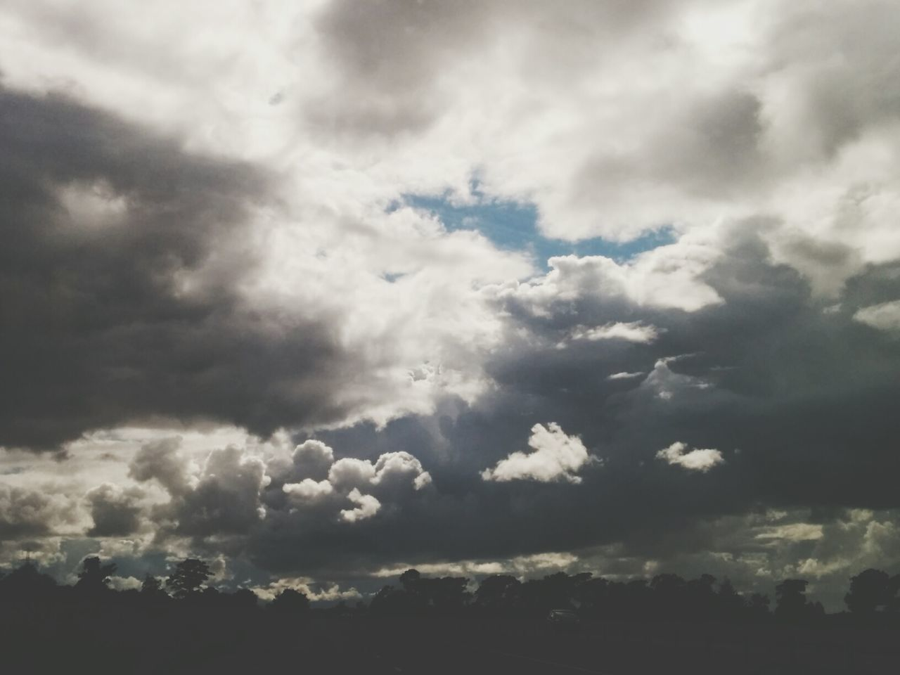 cloud - sky, nature, beauty in nature, sky, atmospheric mood, tranquility, cloudscape, no people, backgrounds, scenics, tranquil scene, weather, outdoors, day, low angle view, full frame, sky only, storm cloud