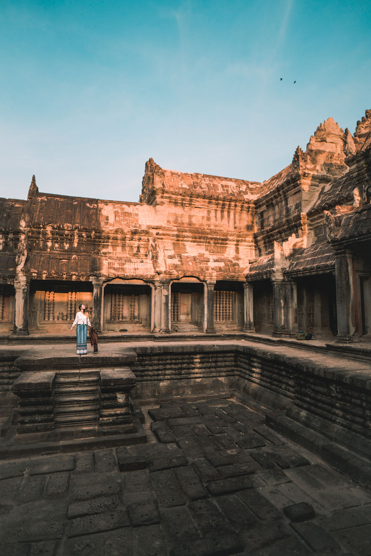 Revel History Travel Destinations Architecture Ancient Civilization Outdoors Day Adult Wonder Of The World Temple Tourism Cambodia ASIA Travel Photography Travel Angkor Wat Showcase May Culture Built Structure One Woman Only Full Length Standing Architecture