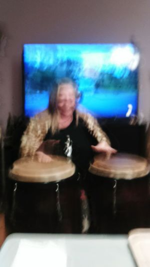 Playing the conga Arts Culture And Entertainment Music One Person Indoors  No Focus Woman