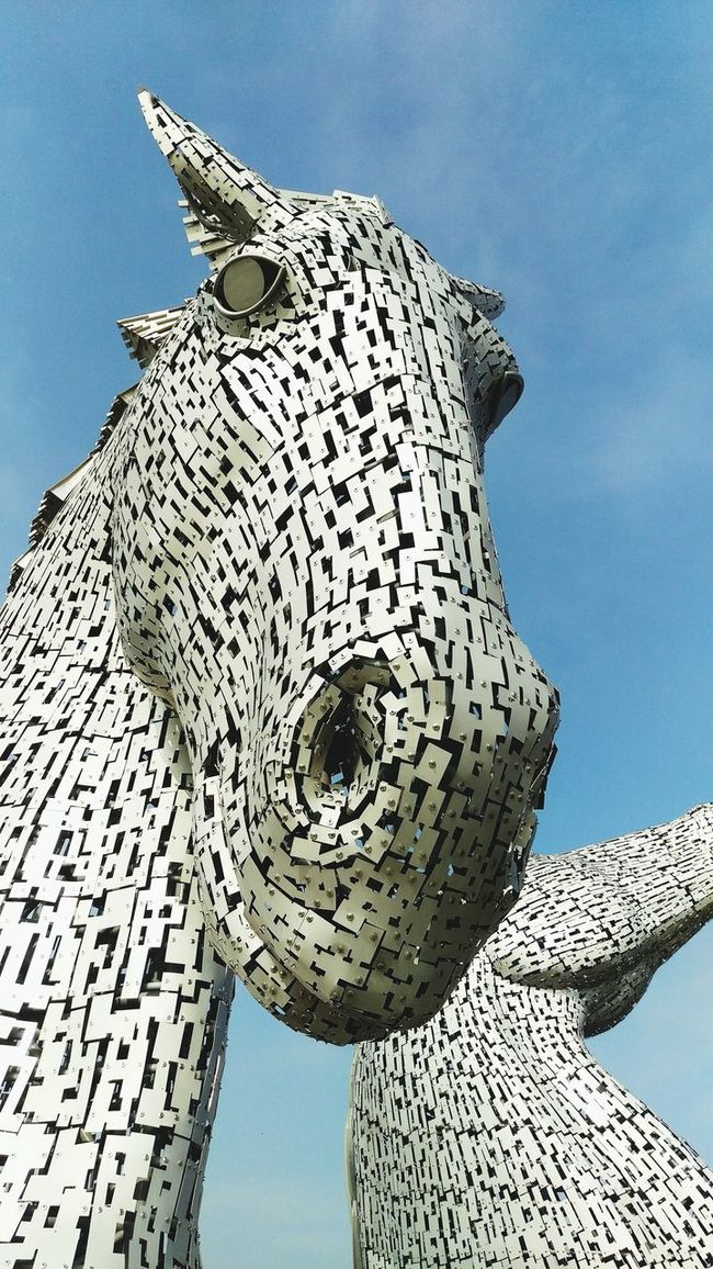 Low Angle View Clear Sky Architecture Built Structure Blue Building Exterior Famous Place Modern Day Sun Architectural Feature Travel Photography Scotland Kelpies  Kelpies Of Falkirk Tall - High Outdoors Tourism