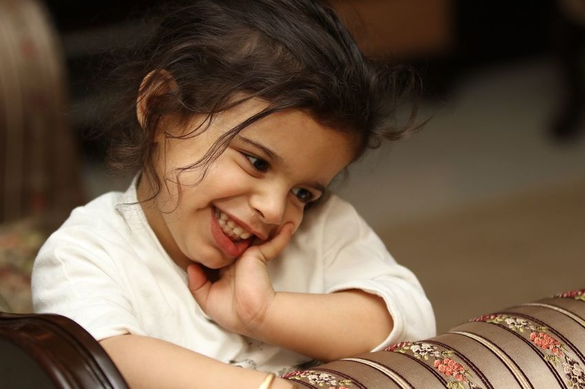 Indoors  Smiling Happiness Casual Clothing Portrait Childhood Posing Shy Girl White Cute