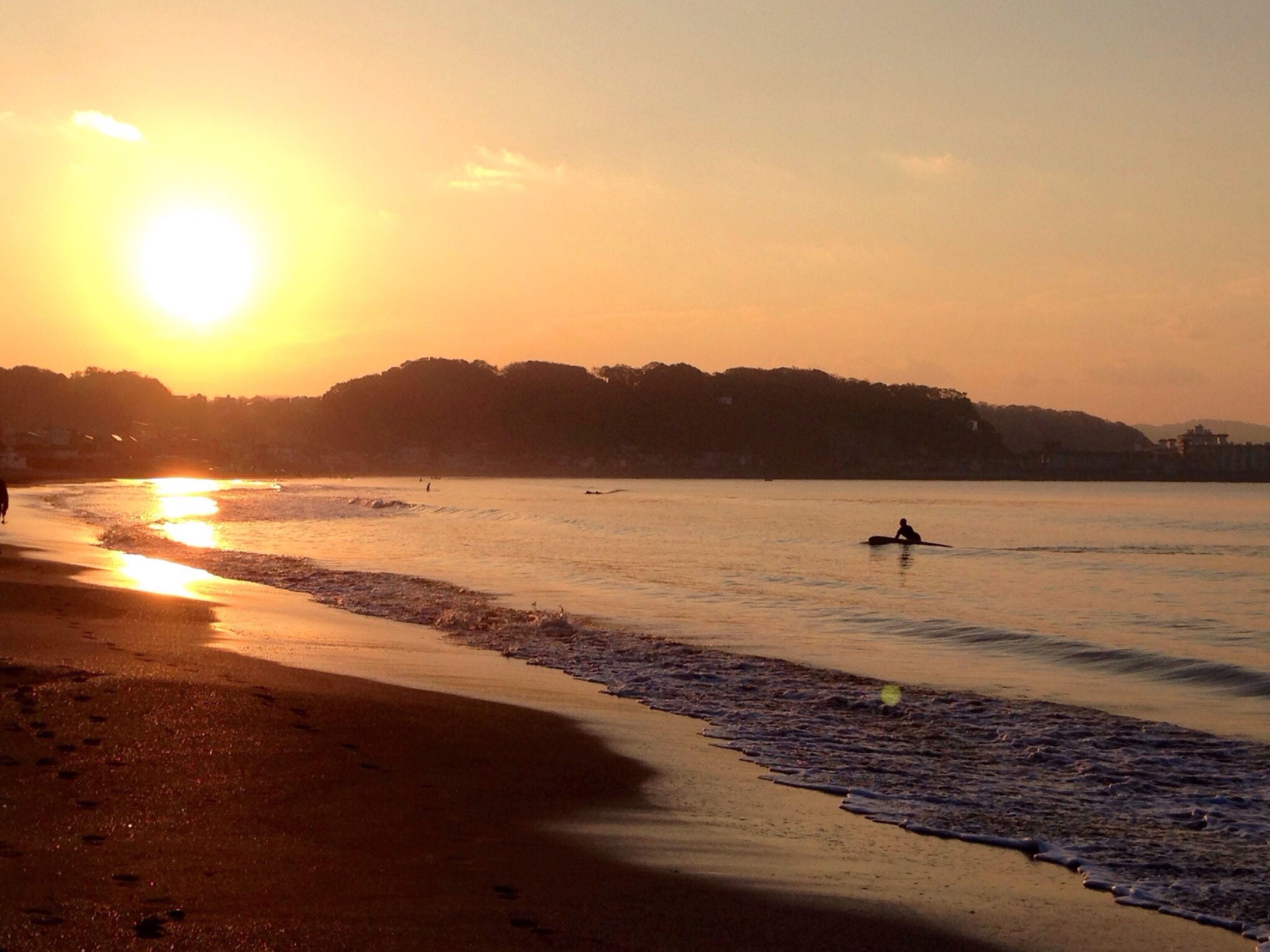 sunset, water, sea, beach, sun, shore, scenics, silhouette, tranquil scene, beauty in nature, tranquility, sunlight, sand, sky, orange color, nature, idyllic, incidental people, nautical vessel, reflection
