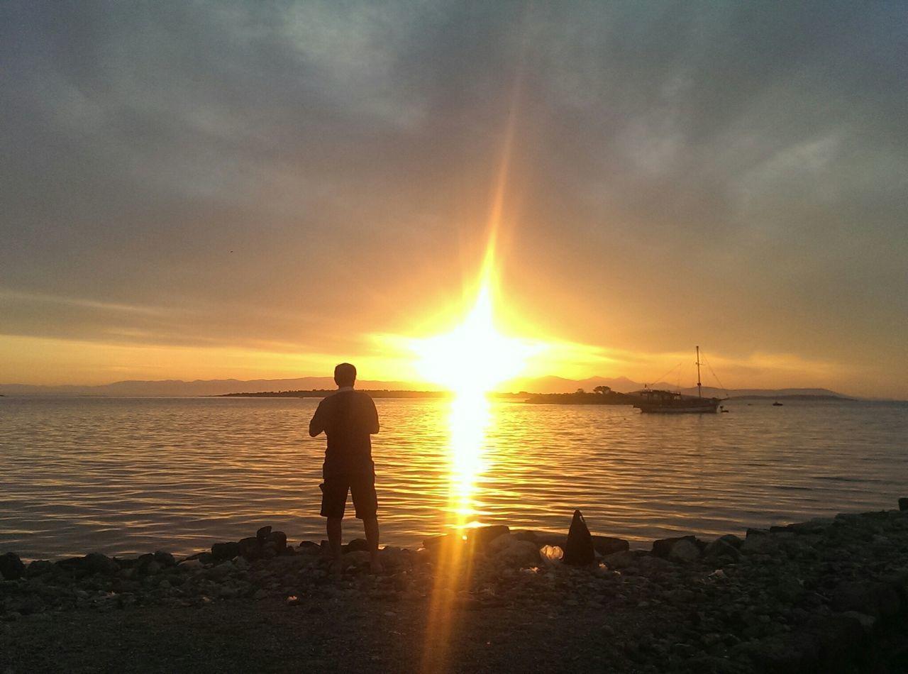 Sun Shining Over Sea During Sunset