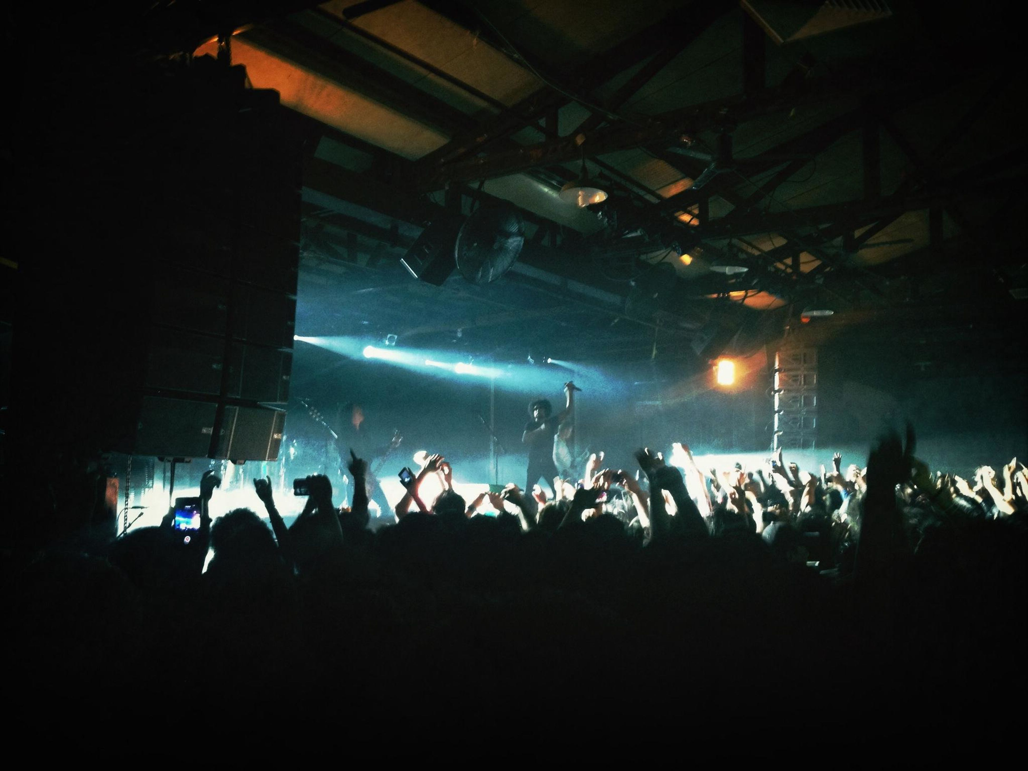 large group of people, illuminated, crowd, indoors, person, night, men, lifestyles, performance, arts culture and entertainment, music, nightlife, stage - performance space, leisure activity, stage light, popular music concert, event, concert
