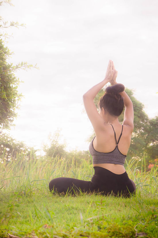 meditation body yoga Body & Fitness Light Meditation Day Exercising Full Length Grass Healthy Lifestyle Leisure Activity Lifestyles Meditation Garden Nature One Person Outdoors People Real People Rear View Sky Sports Clothing Tree Yoga Young Adult Young Women