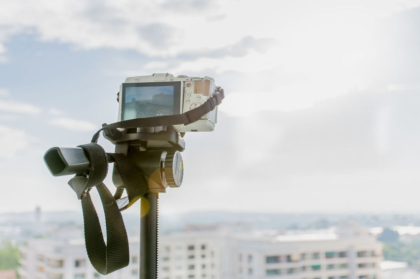 Camera - Photographic Equipment City Close-up Coin-operated Binoculars Day Filming Home Video Camera Lens - Eye Miles Away No People Optical Instrument Outdoors Photography Themes Sky Technology