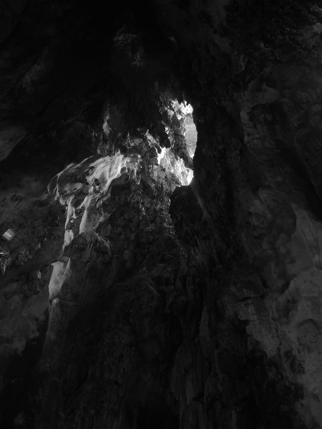 Batu Caves Batu Caves -Malaysia Beauty In Nature Black And White Cave Light Natural Pattern Nature Rock - Object Rock Formation