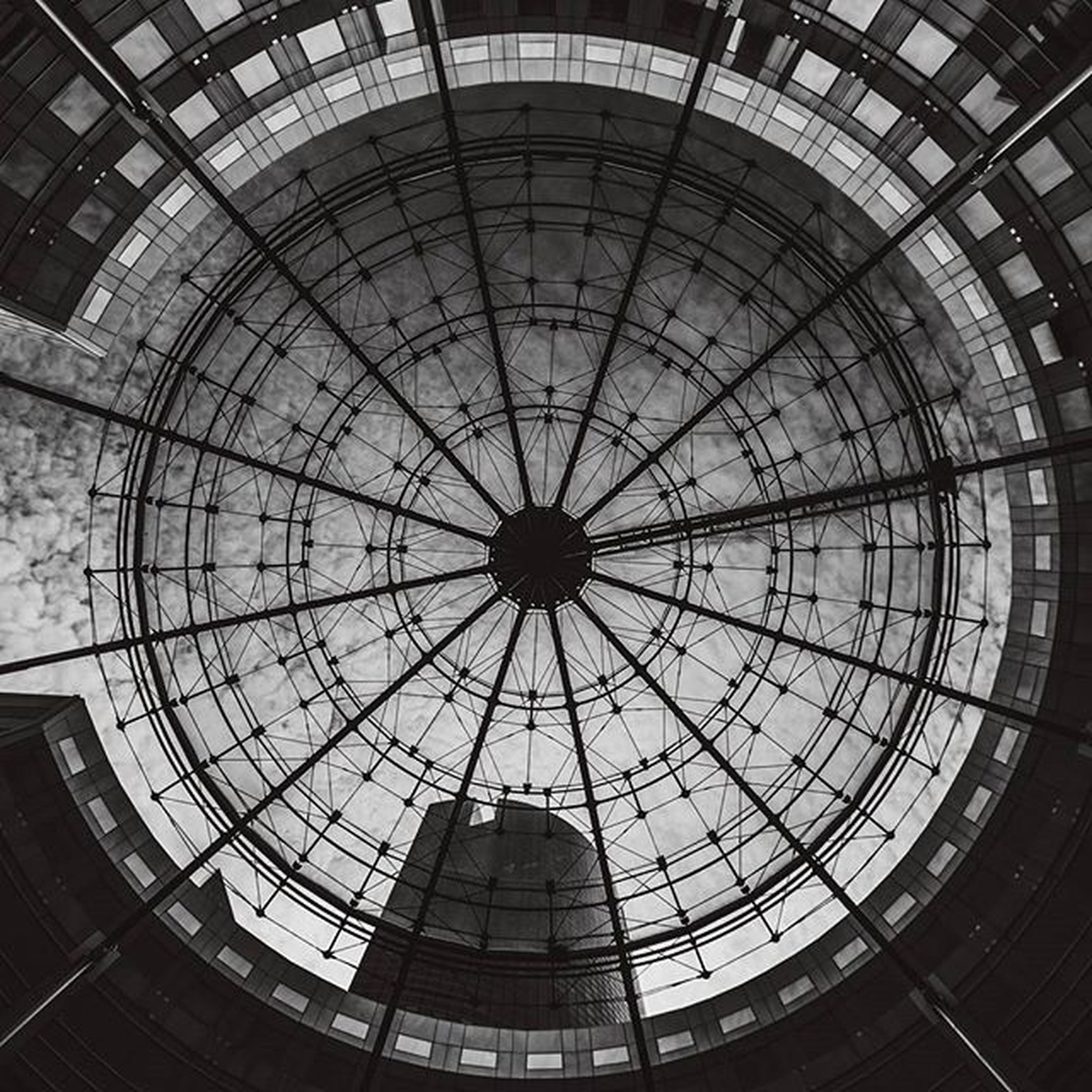 architecture, built structure, ceiling, indoors, low angle view, pattern, skylight, directly below, architectural feature, geometric shape, design, circle, full frame, glass - material, modern, backgrounds, building exterior, building, no people, day